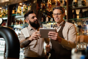 Image or Bar Manager and Staff Member at point of sale